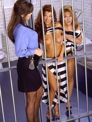 Two jailed honeys having sex with a lesbo cop lots of kissing and grabbing