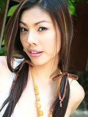 Busty Bookworm May Supha Strips Outdoors