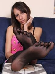 Gorgeous brunette in five toes pantyhose and flip flops shows her perfect feet