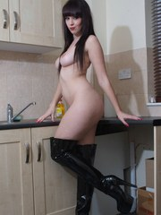 Gorgeous Sammi Jo is completely naked apart from a pair of very sexy leather boots