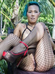 Sweet Julie bares her fishnet stockings as she bares her sweet ass.