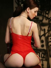 Redhead Zullu flaunts her tight body as she strips her sexy red lingerie.