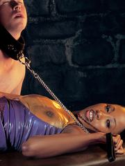 Ebony chick in latex in the dungeon gives blowjob gets anal