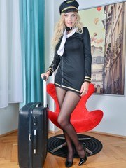 Our fantasy airline pilot big titted blonde Florane gets super pantyhose horny on