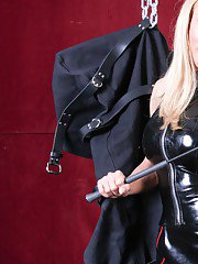 Jake is in trouble. Mistress Monica hung him up in her brand new body bag and leaves