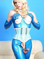Tara Emory puts on a sexy latex outfit and toys her ass with a glass dildo exclusively