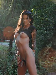 Hot transsexual Morgan Bailey posing her goodies outdoors