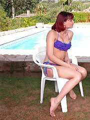 Redhead shemale blowing a load all over babes well-shaped body by the pool