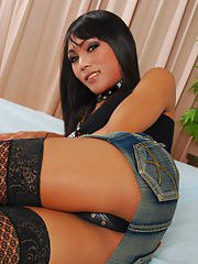 Two sexy ladyboys pose for the camera