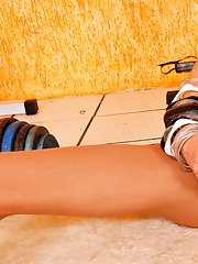 Sporty shemale in sheer-to-waist pantyhose tugging her pecker in the gym