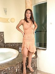 Voluptuous shemale unloading her mighty cock on shiny pantyhose in bathroom