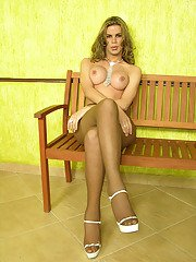 Sexy shemale in high heel sandals showing her long pole in suntan pantyhose