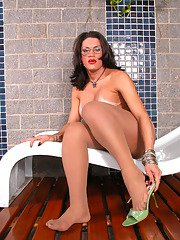 Beautiful shemale satisfying her passion without putting off her shiny hose