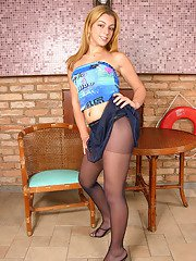 Pretty shemale cant hide her throbbing cock in her control top pantyhose