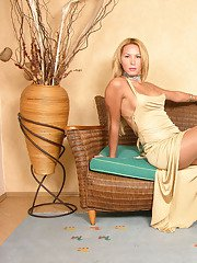 Blonde shemale in shiny hose throwing off her sexy dress and exposing cock