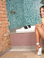 Attractive shemale in silky hose showing her hot cock in various positions