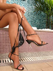 Frisky shemale in stiletto heel shoes spraying cum right on her tan tights