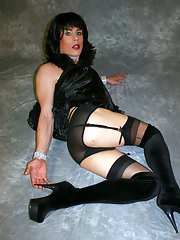 Zoe posing in a sexy black teddy with matching nylon stockings