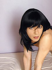 Sultry crossdresser playing with a slutty dominatrix
