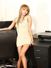 Sexy transsexual Kim stripping in the office