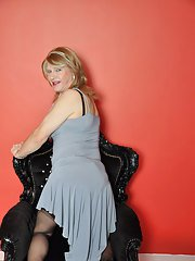 This mature TGirl looks fantastic in her blue dress