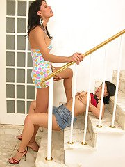 Nasty shemale and cute gal having freaky fun on stairs using cock and hands