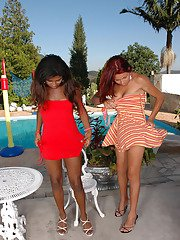 Two steaming hot shemales eagerly undressing to have freaky fun by the pool