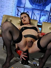 Naughty Kimberly riding on an enormous dildo