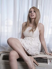 Blonde sweetie Bailey Jay strips and poses