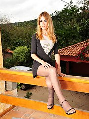 Well-hung t-girl taking kicks from posing outdoors in her elegant pantyhose