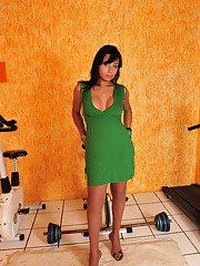 Curvaceous tranny revealing her hard-on lowering a bit her nylon pantyhose