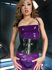 Shes sexy and hung and her cock pushes out against her latex dress anxious to fuck