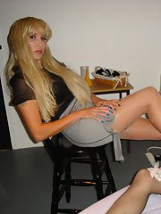 Shy Tgirl covers her face before getting a slow footjob.