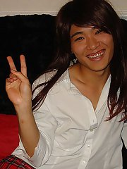 Petite Asian TGirl with a gorgeous smile sucks on some tits and a strapon cock.