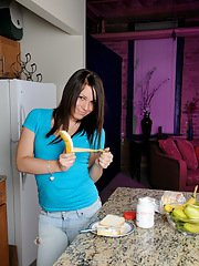 Naughty tgirl Ashley George playing in the kitchen