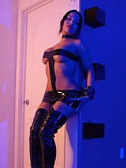 Naughty transsexual Foxxy posing in leather