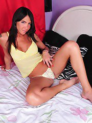 Sexy transsexual Wanessa stripping on the bed