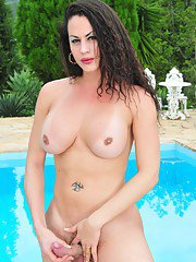 Busty Hot Trannie Posing By The Pool