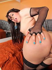 Sexy Colombian transsexual Carolina Estevez takes a huge sausage up her tight tranny
