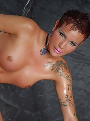 Short hair and very big thick cock on this cute hung tranny