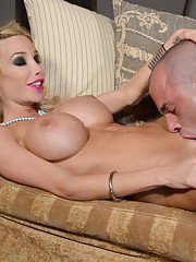 Busty Kimber rides a huge cock