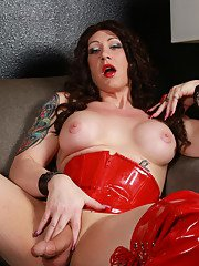 Sexy Kimber toying in corset and boots