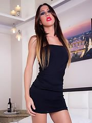 Sensual Tgirl Gabriela strips off her threads and shows you her huge hard cock