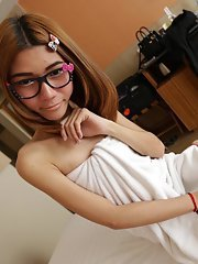 19 year old shy Thai ladyboy gets naked and does a striptease