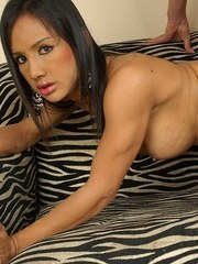 Gorgeous Asian shemale Lucky gets playing with her big tits while her man nibbles