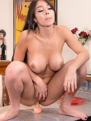 Sexy tgirl gets naked and suck a thick dildo before stuffing it inside her asshole